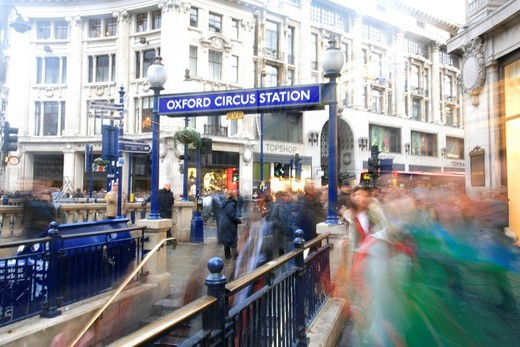 In motion: People hurrying on Oxford Circus during Christmas shopping, London, UK : Stock Photo