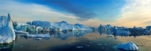 Panoramic view of floating icebergs circa midnight, Disco Bay near Ilulissat, Greenland : Stock Photo