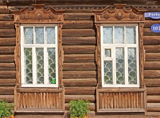 Window of an old Sibirian wooden House, Windowframe from wood, Omsk, Sibiria, Russia, GUS, Europe, : Stock Photo