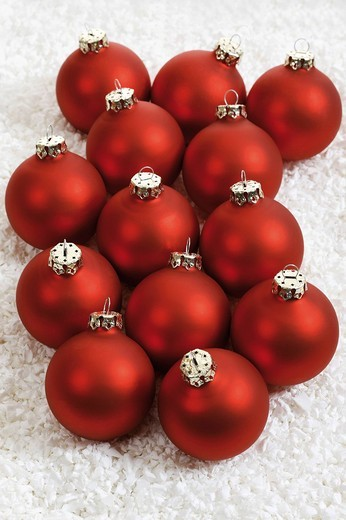 Red Christmas balls on artificial snow : Stock Photo