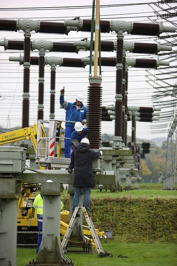 Stock Photo: 1848-156260 Workers doing maintenance work in a transformer station of the ELE, Emscher Lippe Energie GmbH, a subsiduary of the RWE, Marl, North Rhine_Westphalia, Germany, Europe