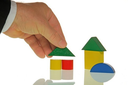 Manager playing with wooden blocks, creative : Stock Photo
