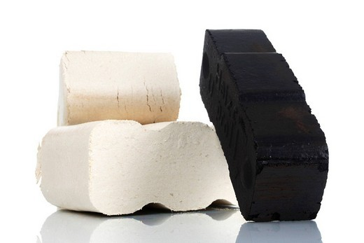 Wood and coal briquettes : Stock Photo