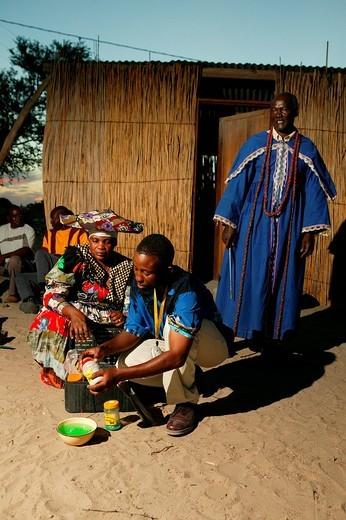 Faith healer preparing medicines, Pentecostal community, Sehitwa, Botswana, Africa : Stock Photo