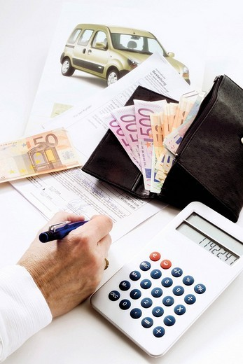 Stock Photo: 1848-157631 Car puchase: contract, calculator, product brochure and a wallet filled with Euros