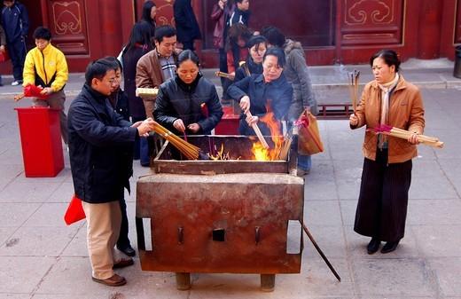 Igniting incense sticks, Tibetan Buddhist temple Yong He Gong, Beijing, China : Stock Photo