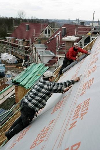 Roofer insulating the roof of a house, Essen, North Rhine_Westphalia, Germany : Stock Photo