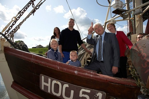 Stock Photo: 1848-1604 German Foreign Minister, Vice_Chancellor and SPD Chancellor Candidate Frank_Walter Steinmeier visiting the shrimp boats of Sven Kaiser and his sons Mika and Finn, Hooksiel, Lower Saxony, Germany, Europe