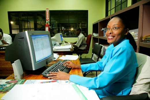 Stock Photo: 1848-161541 Secretary in the harbour office at John Fernandes transshipment port in Georgetown, Guyana, South America