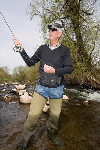 Man fly fishing, Vulkaneifel, Rhineland_Palatinate, Germany, Europe : Stock Photo