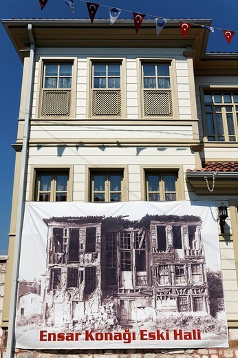 Beautifully restored Ottoman wooden house, with banner of the condition before the restoration, Eyuep Muslim village, Golden Horn, Istanbul, Turkey : Stock Photo