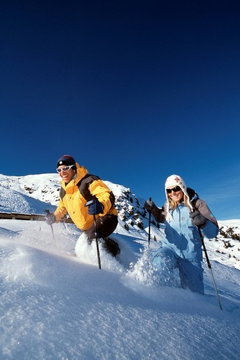 Snow shoe hiking, nordic walking, Weisshorn, Arosa, Grisons, Switzerland : Stock Photo