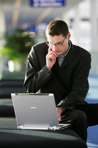 Stock Photo: 1848-165059 DEU Germany : Man is working with a laptop computer. ,
