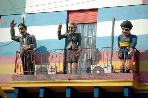 Tango singer Carlos Gardel, Eva Perón and Diego Maradona greeting from balcony at Caminito, La Boca, Buenos Aires, Argentina : Stock Photo