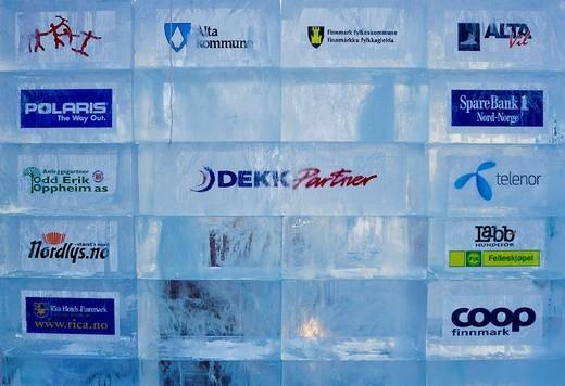 Sponsor´s advertising in blocks of ice at the starting line of the Finnmarksloppet Dogsled Race, Finnmark, Norway, Scandinavia : Stock Photo