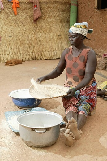 Stock Photo: 1848-165718 Woman winnowing millet, Pakete, Cameroon, Africa