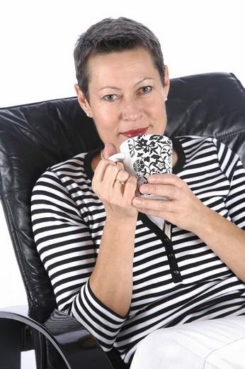 Woman drinking tea : Stock Photo