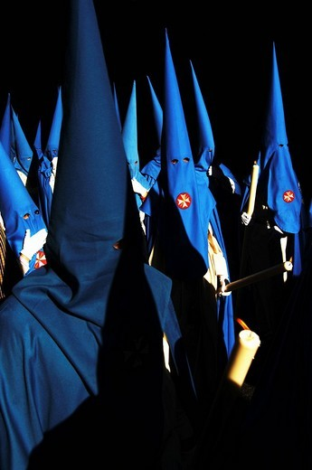 Penitents dressed in blue penitential robes nazareno, Semana Santa, Holy Week Procession, Seville, Andalusia, Spain : Stock Photo