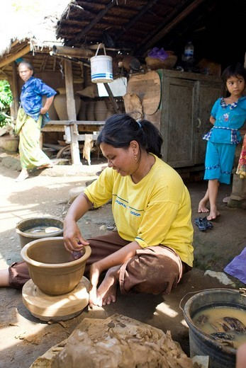Woman crafting a clay jar in the traditional method, Banyumulek, Lombok Island, Lesser Sunda Islands, Indonesia : Stock Photo