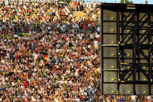Stock Photo: 1848-167840 Lots of people on tribunes in front of a video screen during a football broadcast at the Olympic Stadium, Munich, Bavaria, Germany, Europe