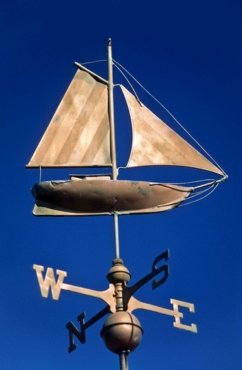 Weather vane with a sailing boat : Stock Photo