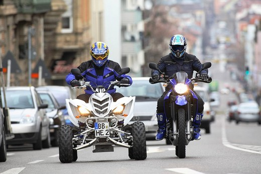 Quad and motorcycle, riding shot : Stock Photo