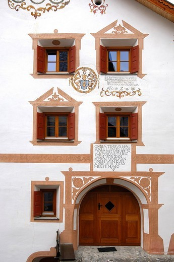 Entrance and windows of an Engadin house decorated with Sgraffito ornaments, Ardez, Lower Engadin, Grisons, Switzerland : Stock Photo