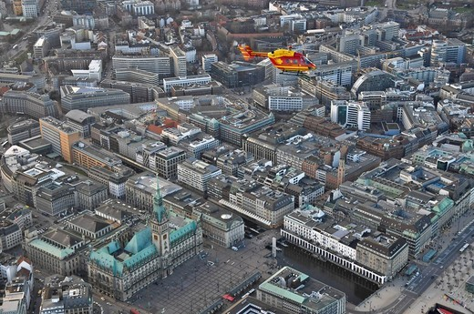 Stock Photo: 1848-169567 Eurocopter Medicopter BK 117 flying over city hall, Hamburg, Germany, Europe
