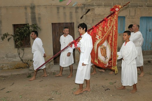 Stock Photo: 1848-170678 Men dressed in white robes preparing for a race with bare feet, holy flag, San Salvatore, Sardinia, Italy, Europe