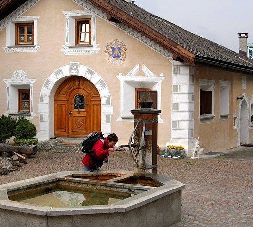At a mineral water fountain, Scuol, Schuls, Lower Engadin, Switzerland : Stock Photo