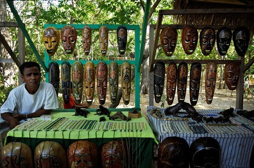 Stock Photo: 1848-171814 Man sitting behind a sales booth selling masks and perls, Komodo National Park, World Heritage Site, Komodo, Indonesia, Asia