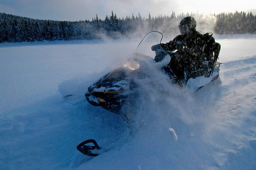 Snowmobile in snow landscape, Saguenay_Lac Saint Jean, Mont Valin Region, Quebec, Canada, North America : Stock Photo