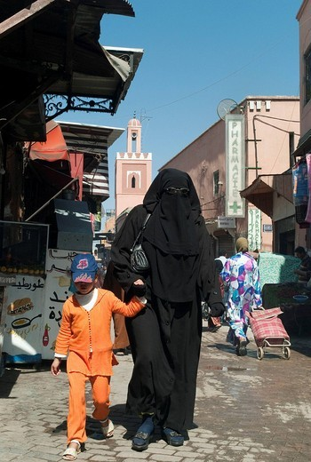 Veiled women, street scene in the old city, the Medina, Marrakech, Morocco, Africa : Stock Photo