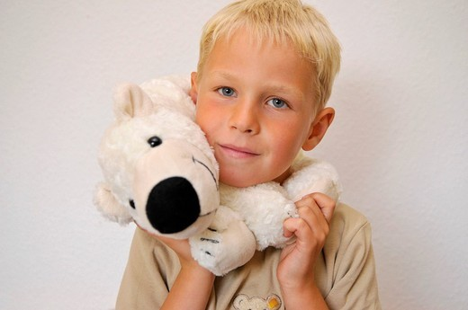 Stock Photo: 1848-172751 Little boy with a cuddly polar bear