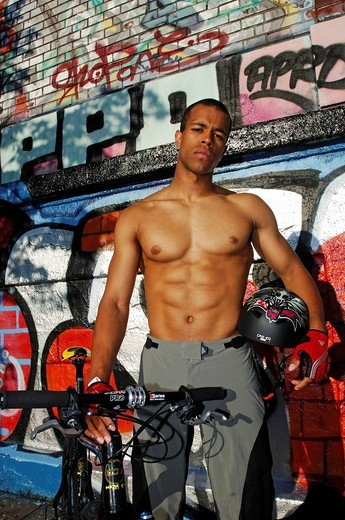 Mountainbiker showing his abs, sixpack : Stock Photo