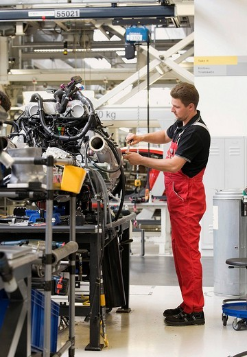 Audi employee assembling the drive unit of an Audi R8 sports car in the Audi R8 assembly hall, Baden_Wuerttemberg, Germany, Europe : Stock Photo