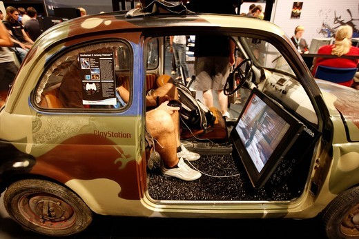 Stock Photo: 1848-174642 Playstation, action games presentation in a small car, at the Entertainment Area of the Gamescom, the world´s largest fair for computer games in the Messe Koeln Exhibition Center, Cologne, North Rhine_Westphalia, Germany, Europe
