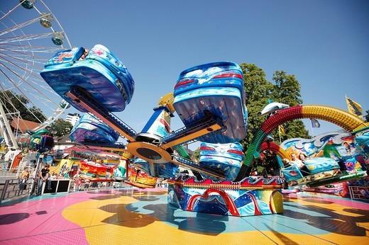 Stock Photo: 1848-175124 Octopussy ride and ferris wheel, Laurentius fair, Bergisch Gladbach, North Rhine_Westphalia, Germany