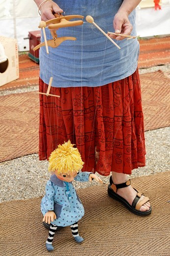 Stock Photo: 1848-175703 Woman demonstrating a theatre marionette, traditional craft market, Flachsmarkt Burg Linn, Krefeld, Lower Rhineland, North Rhine Westphalia, Germany, Europe