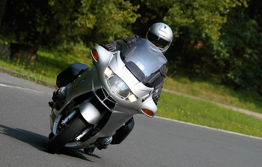 Motorcyclist on a BMW on a bending road : Stock Photo