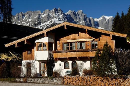 Tirolean_style house and the Wilder Kaiser Range, Going, Tirol, Austria, Europe : Stock Photo