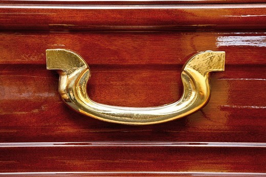 Handle on a wooden coffin : Stock Photo
