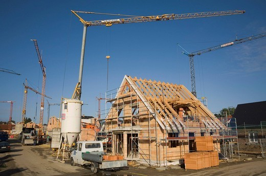 Cranes over a new development area in Waltrop, North Rhine_Westphalia, Germany, Europe : Stock Photo