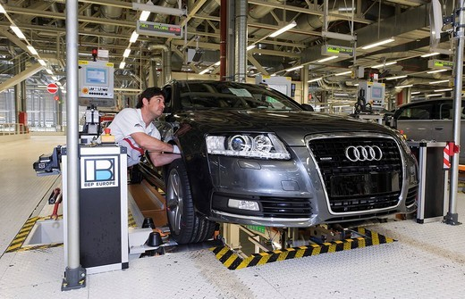Stock Photo: 1848-180431 An Audi employee working on the suspension set_up of an Audi A6 Avant S_Line at the control centre of the Audi plant in Neckarsulm, Baden_Wuerttemberg, Germany, Europe