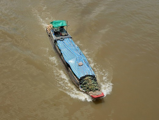 Wooden boat on Mekong River, fruit and vegetable trader, from above, loaded with pineapple, Can Tho, Mekong Delta, Vietnam : Stock Photo