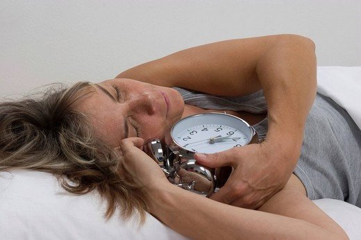 Stock Photo: 1848-183105 Sleeping woman, alarm clock