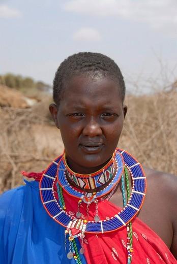 Masai woman shows colourful jewelry around her neck Amboseli National Park Kenya : Stock Photo