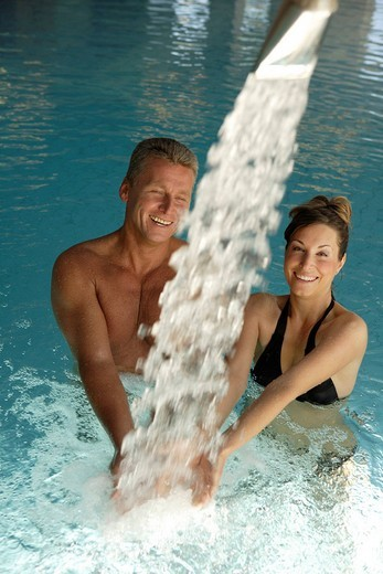 Woman and man in a pool, spa : Stock Photo