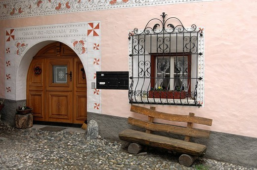 Entrance of an Engadin house decorated with Sgraffito ornaments, Scuol, Schuls, Lower Engadin, Grisons, Switzerland : Stock Photo