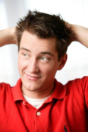 Stock Photo: 1848-187313 Young man relaxed leaning back, smiling